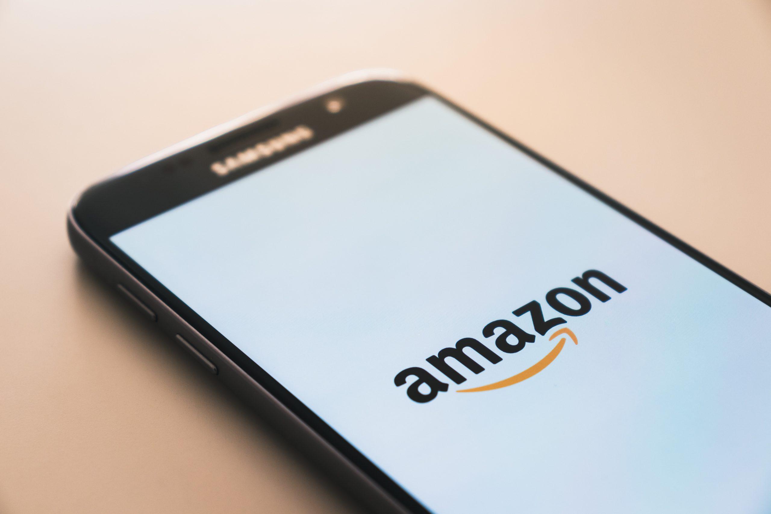 black Samsung Galaxy smartphone displaying Amazon logo