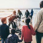 group of people standing on seashore